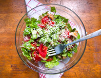Bowl of salad on wooden table stock photo