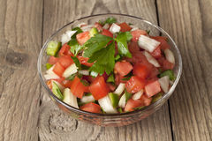 A bowl with salsa mexicana. Close-up image of a bowl with salsa Mexicana on a wooden table Stock Photos