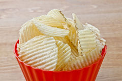 Bowl of salted chips Stock Photo