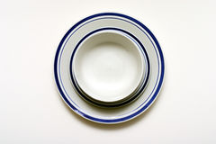 Bowl, Saucer and Plate. Stacked dishes on white background Royalty Free Stock Photo