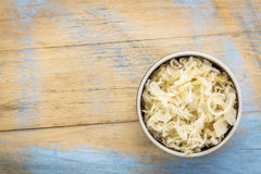 Bowl of sauerkraut. On a grunge wood with a copy space Royalty Free Stock Photography