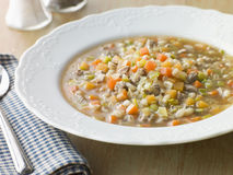 Bowl of Scotch Broth. With Salt and Pepper and Soup Spoon Royalty Free Stock Images