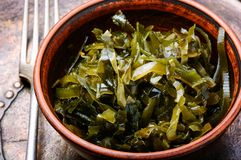 Bowl of sea kale. Pickled sea kale in the bowl.Fresh seaweed salad royalty free stock photography