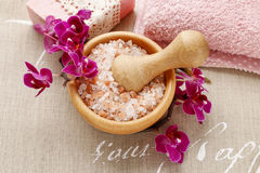 Bowl of sea salt and orchid flowers Royalty Free Stock Images