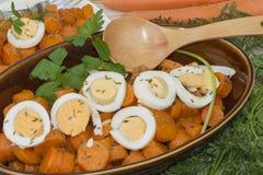 Bowl with seasoned carrots royalty free stock photos
