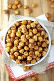 Roasted Chickpeas. Bowl of seasoned, roasted chickpeas Stock Image