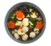 Bowl of seaweed and meatball on white Stock Images