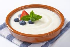 Bowl of semolina pudding with fruit. Bowl of semolina pudding with fresh fruit on striped napkin - close up Stock Photos