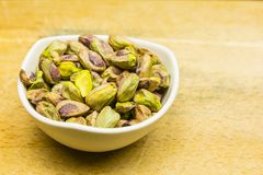 Bowl with shelled, roasted pistachios. royalty free stock photo