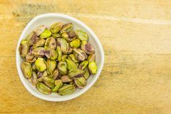 Bowl with shelled, roasted pistachios. View from above. stock images