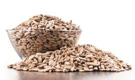 Bowl of shelled sunflower seeds  on white Stock Image