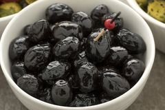 Bowl with shiny black olives Stock Photography