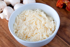 Bowl of shredded cheese Stock Image