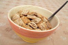 Bowl of shredded wheat cereal Stock Photos