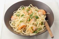 A bowl of shrimp scampi. Close up of a brown bowl of shrimp scampi Royalty Free Stock Image