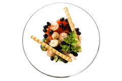 Bowl With Shrimps Salad And Breadsticks. Food & Drinks - Mediterranean Recipes - Shrimps salad with black olives, cherry tomatoes, cucumber and breadsticks Stock Photo