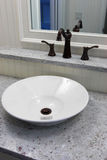 Bowl sink. Porcelain bowl sink with bronze fixtures and mirror stock images