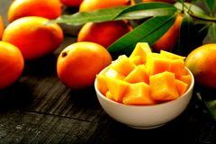 Bowl of sliced sweet mangoes. Stock Images