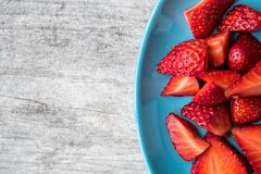 Bowl of Slices of Strawberries stock images
