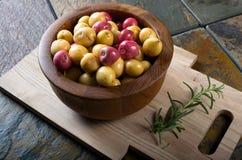 Bowl of small organic potatoes. A wooden bowl of small organic potatoes.  Starch vegetable Royalty Free Stock Image