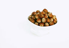 Bowl with a smile full of hazelnuts. Isolated bowl with a smile full of hazelnuts Stock Photos