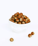 Bowl with a smile full of hazelnuts. Isolated bowl with a smile full of hazelnuts stock photography