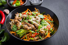 Bowl of soba noodles with beef and vegetables. Asian food. Royalty Free Stock Image