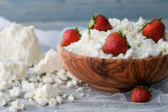 A bowl with some cottage cheese and strawberries Stock Images