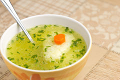 Bowl of soup. Soup with dumplings, carrot and parsley Stock Photo