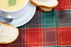 Bowl of soup and bread Stock Photos