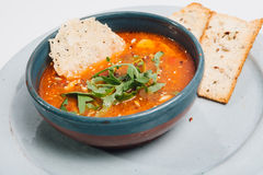 Bowl with soup and bred Stock Photo