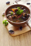Bowl of soup with kidney beans and  mushrooms Stock Photos