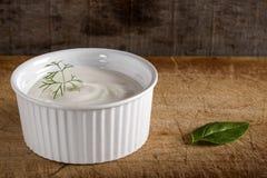 Bowl of sour cream Stock Photos