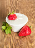 Bowl with sour cream and strawberries Royalty Free Stock Photography