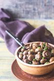 Bowl of soy balsamic roasted mushrooms. On the wooden table Stock Image