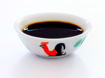 Bowl of soy sauce Royalty Free Stock Images