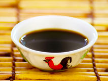 Bowl of soy sauce royalty free stock photos
