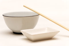 Bowl, soy sauce, chopsticks 2. Bowl and empty soy sauce dish with a couple of chopsticks Stock Photography