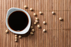 A bowl of soy sauce and soy grains Stock Image