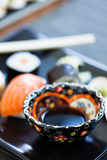 Bowl soy sauce on sushi plate Royalty Free Stock Photos