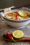 Bowl of spicy Asian soup with noodles Stock Photo