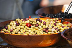 Bowl of spicy olives at market stand stock photo