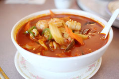 Bowl of spicy seafood soup Stock Photos