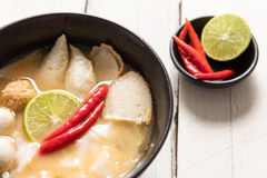 Bowl of spicy soup with noodles and vegetables for a delicious a Stock Photos
