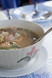 Bowl of spicy Thai Tom Yum Soup Royalty Free Stock Image