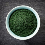 Bowl of spirulina algae powder Royalty Free Stock Images