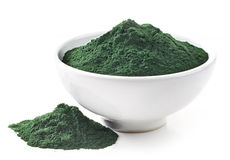 Bowl of spirulina algae powder. On white Stock Photo