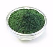 Bowl of spirulina algae powder Royalty Free Stock Photos