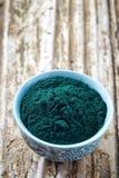 Bowl of spirulina algae powder Royalty Free Stock Image