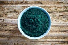 Bowl of spirulina algae powder Royalty Free Stock Photography